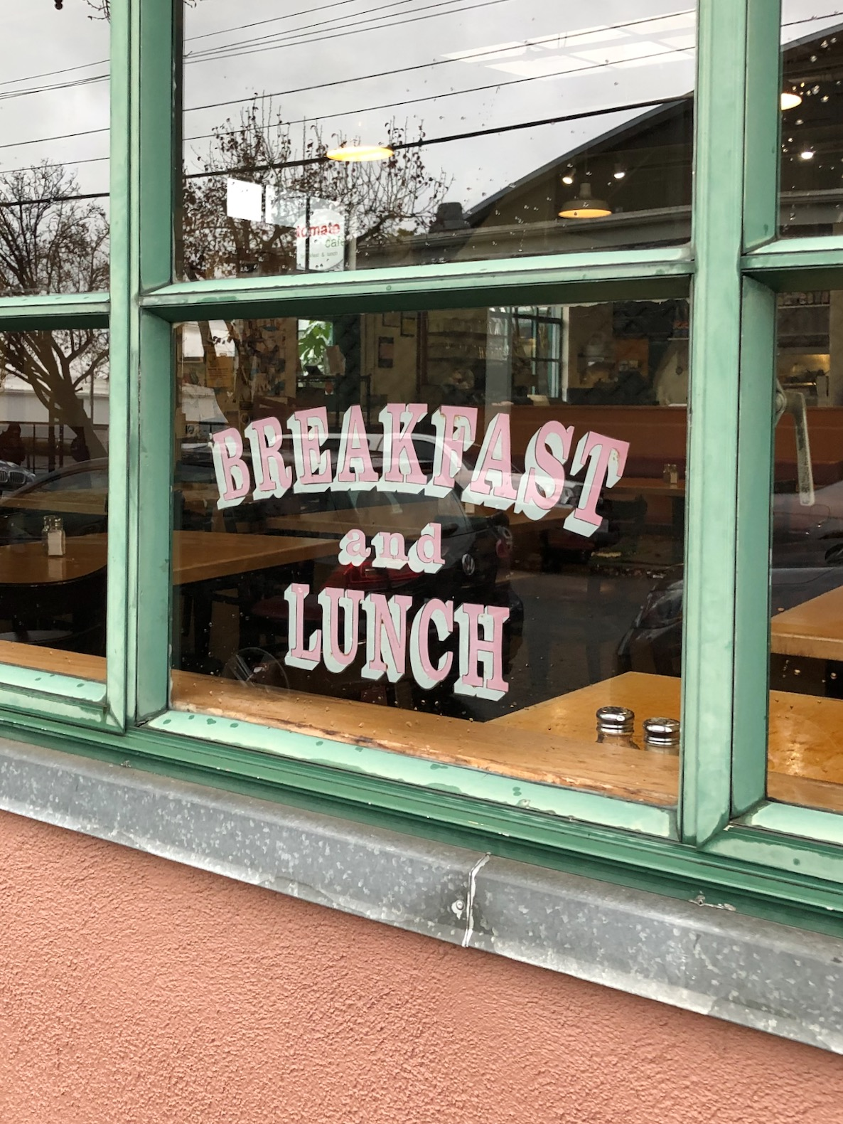 window of restaurant with breakfast and lunch sign